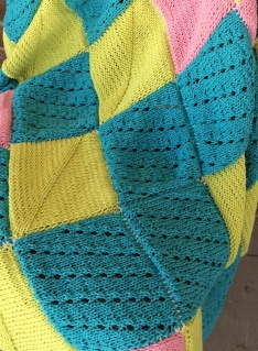 Free pattern for a knit blanket, how to knit lace, pattern and tutorial by April Garwood of Banana Moon Studio