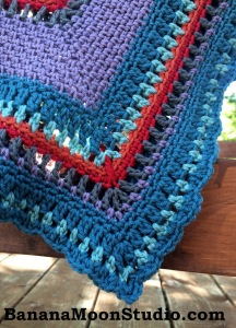 FREE crochet pattern for a colorful seed stitch baby blanket by April Garwood of Banana Moon Studio