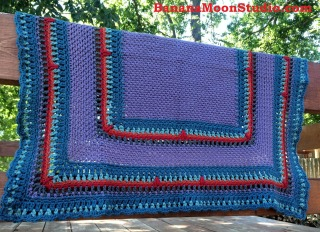 FREE crochet pattern for a baby blanket made in seed or moss stitch by April Garwood of Banana Moon Studio