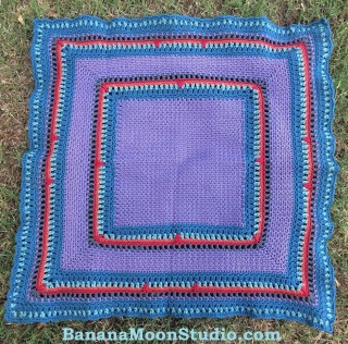 FREE crochet baby blanket pattern by April Garwood of Banana Moon Studio. Colorful, worked mostly in moss or seed stitch.