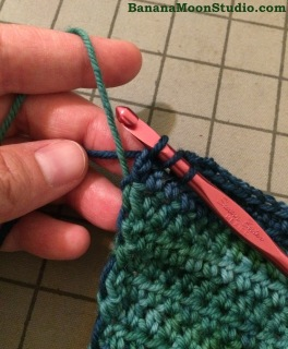 How to carry yarn up the side of your crochet project when working with multiple colors. By April Garwood of Banana Moon Studio.