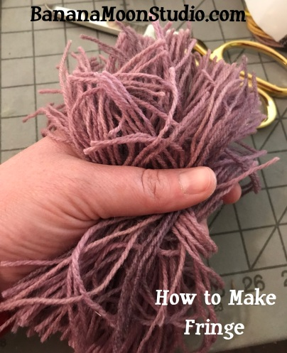 How to easily cut fringe for a crochet or knitting project, a tutorial by April Garwood of Banana Moon Studio