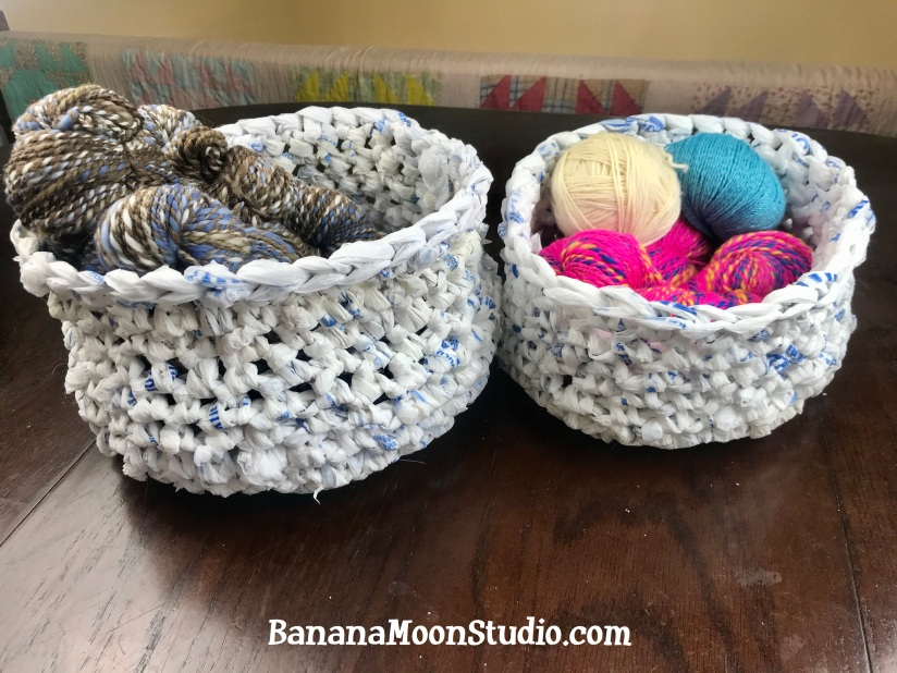 Crochet with plastic bags to make these round baskets. Free pattern from Banana Moon Studio.