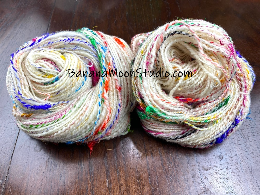 Two skeins of handspun yarn. Handspinning with recycled sari silk threads, video tutorial and product review from Banana Moon Studio.