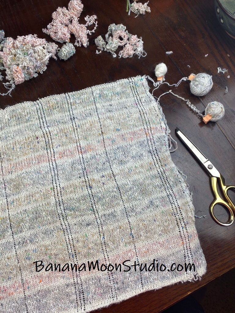 Ready to unravel the front panel. Yarn from thrift store sweaters, a photo tutorial from Banana Moon Studio.