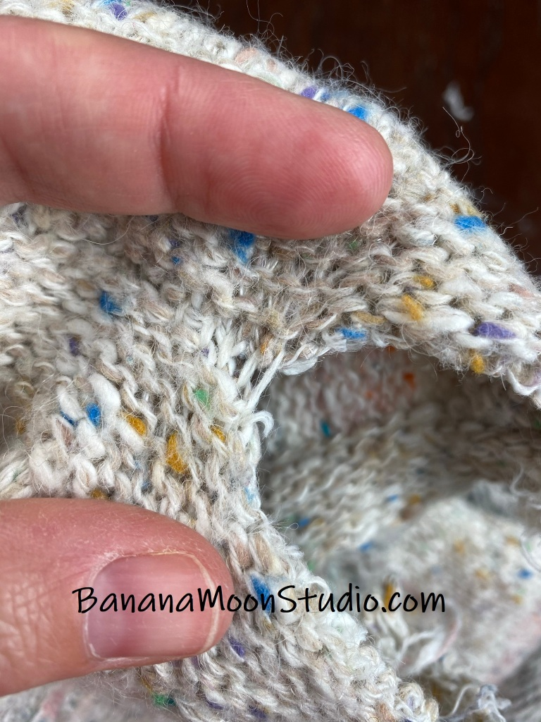 How to take apart a knitted sweater from a thrift store to recycle the yarn. Stretch the seams open as you cut the seaming stitches. Photo tutorial from Banana Moon Studio.