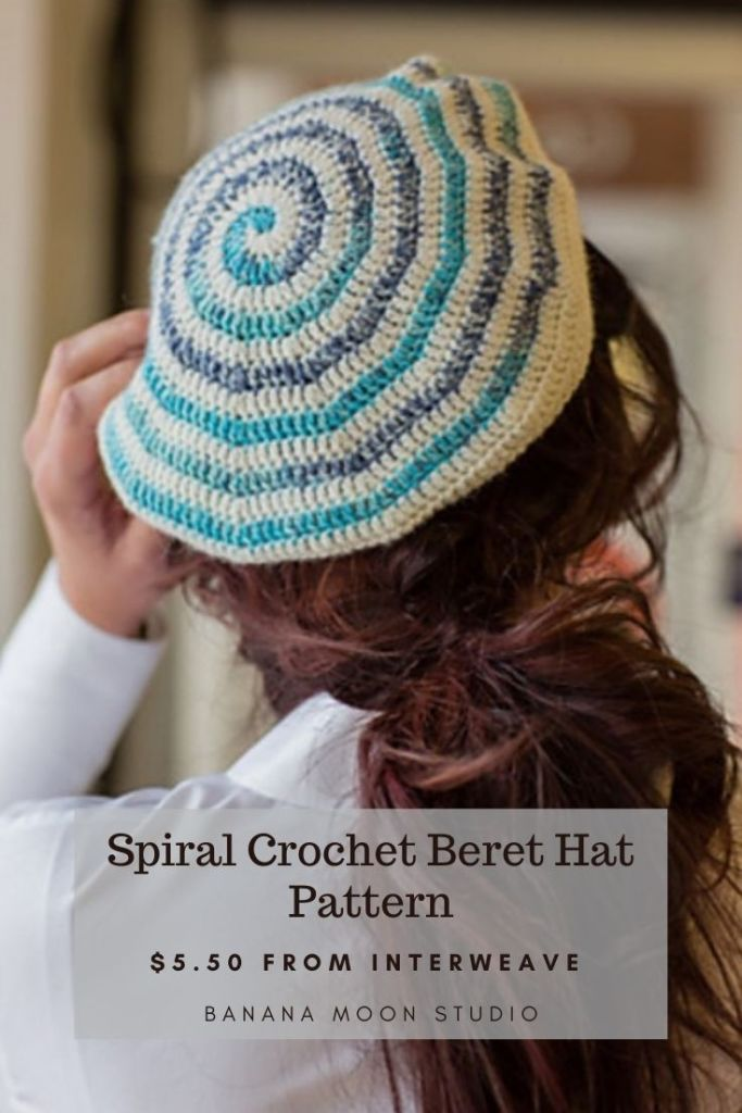 Woman facing away in a crochet spiral beret that is white and blue. Crochet spiral beret hat pattern from Banana Moon Studio and Interweave.