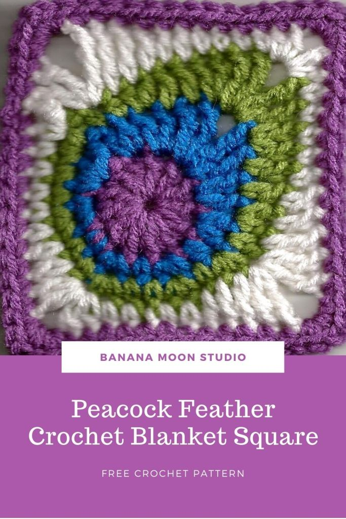 Crochet peacock feather granny square with purple, blue, green, and white.
