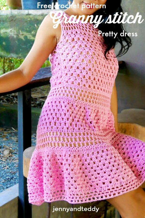 Woman wearing a pink granny stitch and lace sleeveless dress.